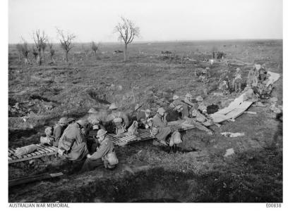 20th Bn. Resting on duckboards at the Railway Dugout near San Souci en route to Zonnebeke.10.1917. Photographer J.H. Hurley. Photograph source AWM E00838