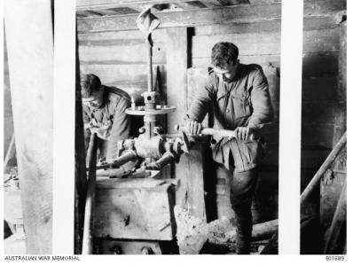 3rd Australian Tunnelling Coy. drilling a ventillation hole in a tunnel 1917. Photographer unknown, photograph sourced AWM E01689