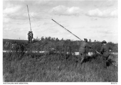 4th Division Signal Engineers laying Communication Lines prior to the battle on the Hindenburg Line September 1918. Photographer unknown, image source AWM E03272