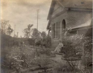 Elsie Hillman in the garden of 70 East Street, Guildford. Photograph from the Helene B. Huelin Collection, source Hillman family