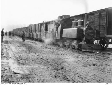 Ammunition transfer from Broad Gauge to Light Gauge Rail, Frizeville, Belgium 1917. Photographer unknown, photograph source AWM C01357