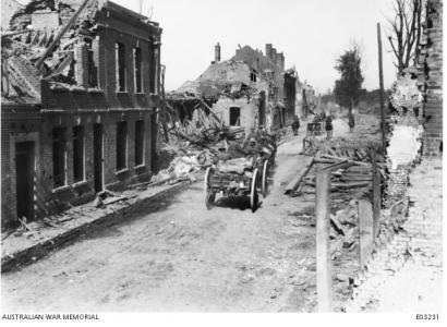Australian FAB passing through the streets of Peronne, France. Photographer unknown, photograph source AWM E03231