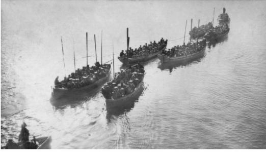 Australian Troops being towed ashore at Gallipoli 1915. Photographer R.M. Bowman, photograph source AWM P2194.005