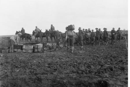 Carrying ammunition to the Australian Artillery front line, the day prior to the Battle of Amiens 7.8.1918 . Photographer unknown, photograph source E02849