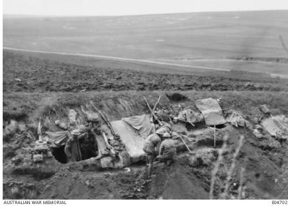 Dugout in  a collapsed  section of road, Morlancourt 1918. Photographer unknown, photograph source AWM E04702