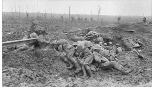Exhausted stretcher bearers Zonnebeke 1917. Photographer unknown, photograph source AWM E00976