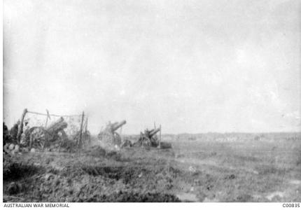 Firing at Passendaele Ridge 1917. Photographer E.C. Barnes, photograph source AWM C00835