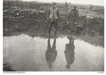 Frozen, water filled shell crater, Wytschaetes Ridge, Messines 1917. Photograph sourced AWM H17002
