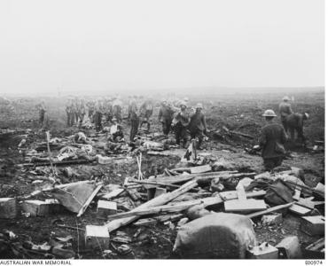 German prisoners carrying in the wounded to Regimental First Aid Post near Clapham Junstion. Photographer unknown, photograph source AWM E00974