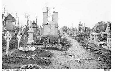 Grave of W.J. Conaughton in foreground at Villers-Bretonneux 1919. Photographer unknown, image sourced AWM E04404