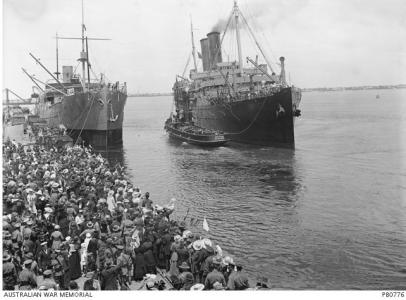 HMAT 'Orsova' is pushed from the wharf by tugboat 'Racer', Melbourne 1916. Photographer unknown, photograph source AWM B0776