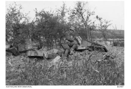 Major A. M. Phillips beside a trench mortar captured by the 11th Bn. at Mont de Merris, June 1917. Photographer unknown, photograph source AWM E02487