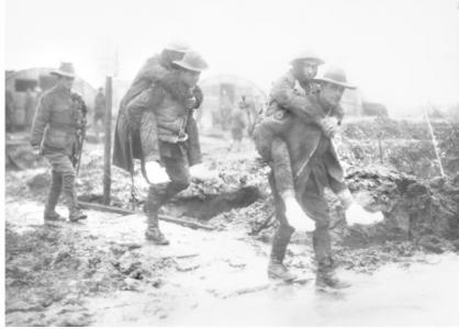Men of the 14th AFA carrying soldiers with trench feet, Dec. 1916. Photographer unknown, photograph source AWM E00081