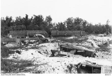 Mont St Quentin Village-shell damaged trenches and town wall 1918. Photographer unknown, Photograph source AWM E05311