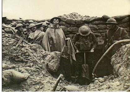 Ploegsteert, Belgium 1917. British Army soldiers pumping water from a trench.. Photograph donor British Offical Photograph No. D705. Photograph source AWM H09026