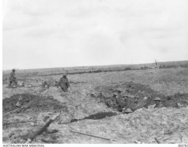 Polygon Wood, Australian soldiers on shell holes. Photographer unknown, photograph source AWM E00783