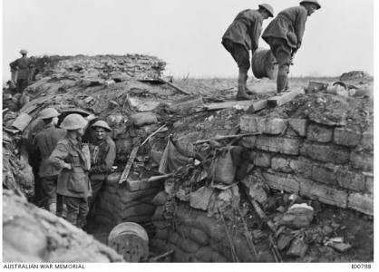 Signal engineers laying cable on Westhoek Ridge during the Battle of Zonnebeke September 26th 1917. Photographer unknown, photograph source AWM E00798