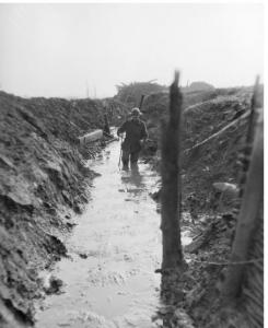 Soldier walking in winter trench 1917. Photographer unknown, photograph source AWM E01497