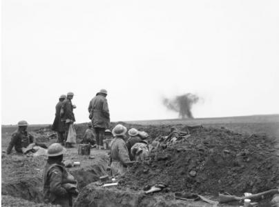 Soldiers watch shell burst near the 51st Bn reserve line trench, Lavieville France 28.3.1918. Photographer unknown, photograph source AWM E01854
