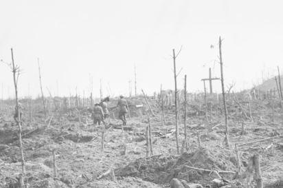 Stretcher bearers passing through a cemetery at Polygon Wood 1917. Photographer unknown, photograph source AWM E01912