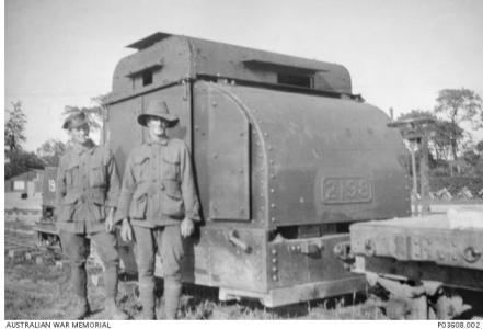 Two Australian Soldiers in front of a Simplex 40hp armoured tractor of the sort supplied to the Australian Light Railway c1917-18. Photographer unknown, image courtesy AWM P03608.002