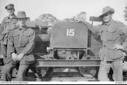 Unidentified soldiers from one ofthe  Australian Railway operating companies next to a Simplex-narrow gauge tractor. Photograph sourced from the AWM P03608.01
