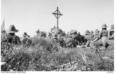 Unveiling the Memorial to those who fell from the 24th Bn. Pozieres- Mouquet Farm July 1917. Photographer unknown, donor Mr.E. Basling, photograph source AWM J03245