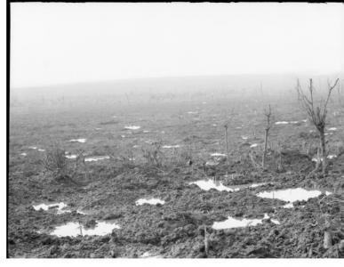 View across shell holes from Broodsiende Ridge, Passchendaele area, Ypres. Photograper unknown, photograph source AWM E01149