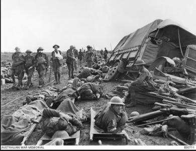 Wounded soldiers waiting to be taken to the Casualty Clearing Station. Photographer unknown, photograph source AWM  E00701
